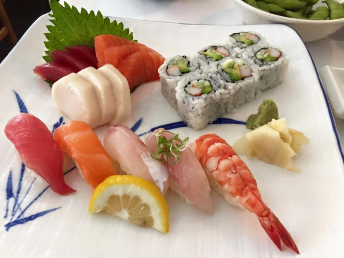 Sushi, sashimi and rolls on a plate.