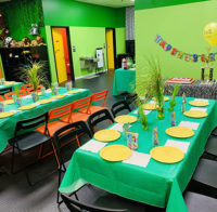 Green tables in a green room.